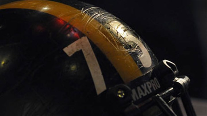 "Mean Joe Greene helmet close Scars line the helmet belonging to the Steelers' No. 75 ""Mean"" Joe Greene."
