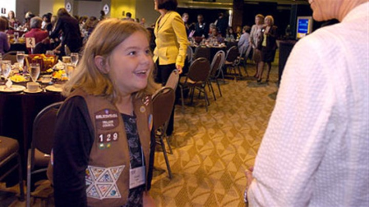 Meeting Sally Gracie Eddie, 9, of Peebles Elementary School in McCandless, is all smiles as she talks to former astronaut Dr. Sally Ride yesterday at the Heinz Field East Club Lounge.