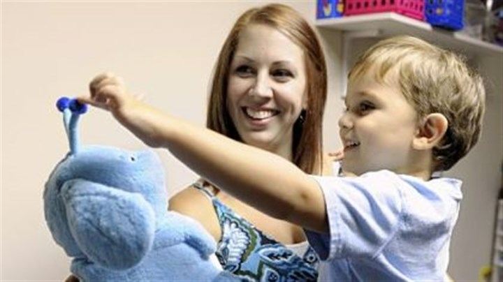 Megan and Duncan Naughton Megan Naughton of Ross holds her son, Duncan, 3, as he interacts with Popchilla, a robot at the Autism Center of Pittsburgh in McCandless. The robot is used to help children with autism with limited or no verbal skills.