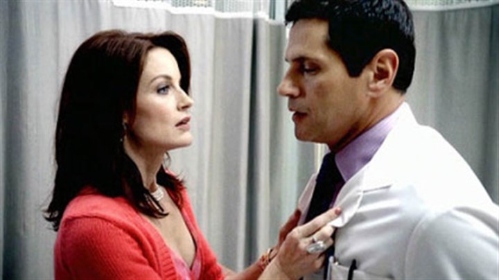 Melrose Place Laura Leighton as Sidney, Thomas Callabro as Dr. Michael Mancini.