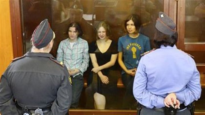 Members of the all-girl punk band Pussy Riot Members of the all-girl punk band Pussy Riot -- from left, Yekaterina Samutsevich, Maria Alyokhina and Nadezhda Tolokonnikova -- sit in a glass-walled cage Friday as a Moscow court handed a two-year jail sentence to the feminist rockers.
