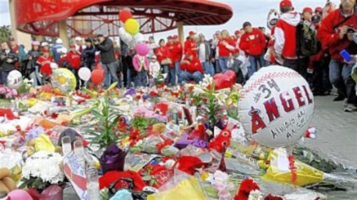 Memorial Angels fans gather around a temporary memorial for Los Angeles rookie pitcher Nick Adenhart before the game against the Red Sox last night in Anaheim, Calif.
