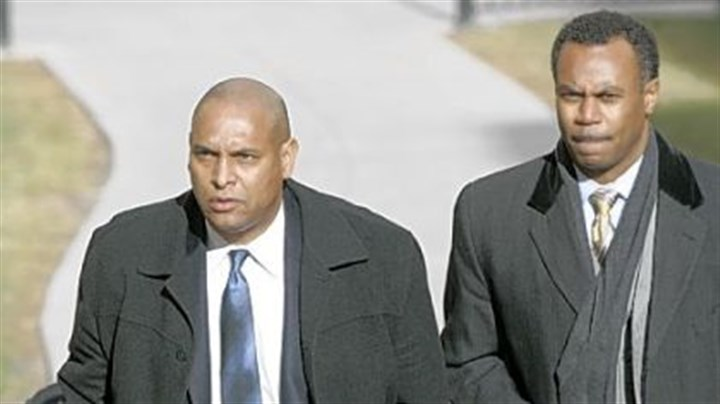 Michael Haywood Michael Haywood, left, and attorney Andre Gammage head into court Monday.