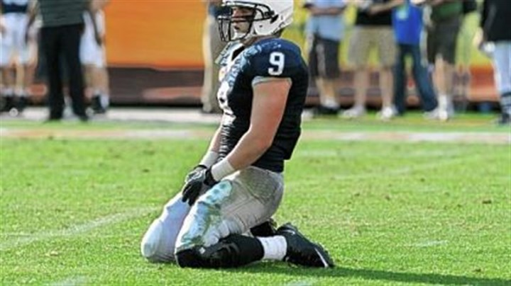 Michael Zordich Penn State running back Michael Zordich falls to his knees after a turnover against the Florida Gators in the 25th Outback Bowl at Raymond James Stadium in Tampa, Florida.