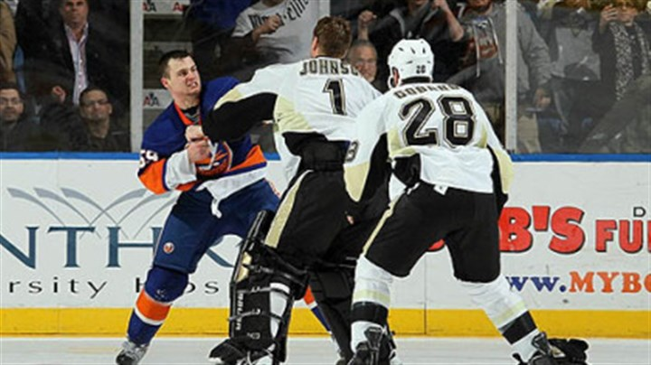 Micheal Haley, Brent Johnson and Eric Godard Islanders forward Micheal Haley fights Penguins goaltender Brent Johnson in the third period of Friday's game at Nassau Coliseum in Uniondale, New York as Penguins forward Eric Godard joins in.
