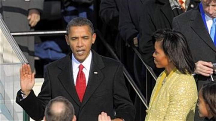 Michelle Obama holds Abraham Lincoln's Bible Michelle Obama holds Abraham Lincoln's Bible for her husband as he takes the oath of office of president, administered by Chief Justice John Roberts on Jan. 20, 2009.