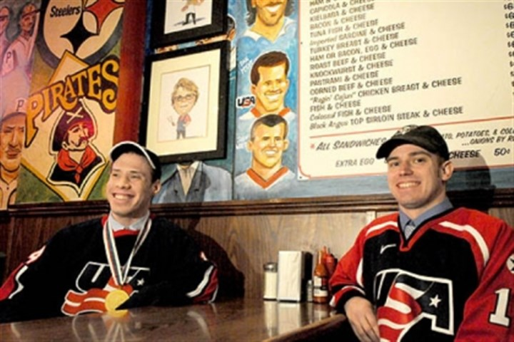 mighty penguins primanti bros Dan McCoy, left, and Josh Wirt, both members of the Mighty Penguins sled hockey team, smile in front of their likenesses on a mural at the original Primanti Bros. in the Strip District.
