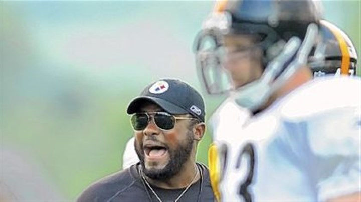 Mike Tomlin Steelers head coach Mike Tomlin provides some motivation for his players during training camp at Saint Vincent College in Latrobe.