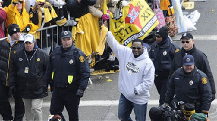 Mike Tomlin Mike Tomlin waves to the legion of Steelers fans who turned out for the Super Bowl victory parade.