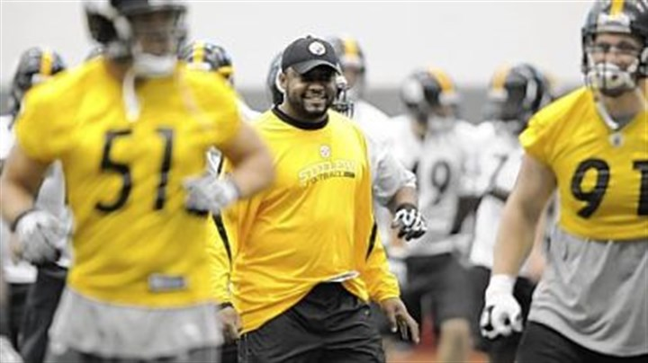 Mike Tomlin Steelers head coach Mike Tomlin watches as his team goes through drills.