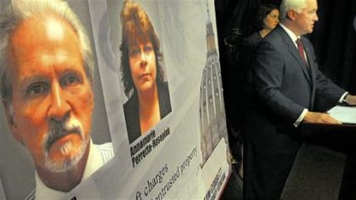 Mike Veon State Attorney General Tom Corbett, right, outlines the charges against Mike Veon and Annamarie Perretta-Rosepink, whose photos are mounted on the board, during a news conference yesterday.