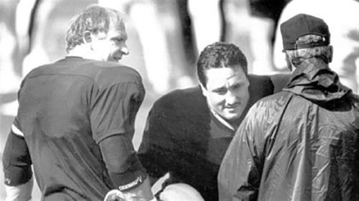 Mike Webster and Ben Lawrence Mike Webster helps replacement player Ben Lawrence stretch before a workout in the 1987 strike camp in Johnstown.