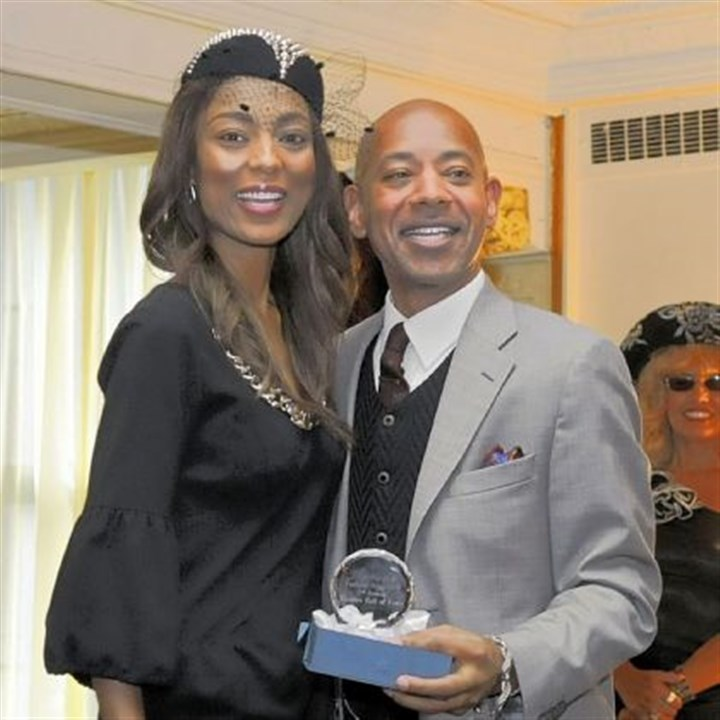 Miyoshi Anderson Pittsburgh Fashion Week founder Miyoshi Anderson, seen here with LaMont Jones.