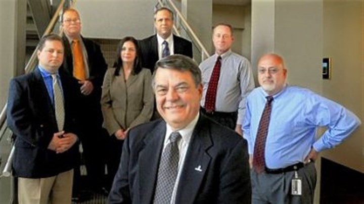 Mobile MBA program GAI Consultants CEO Gary M. DeJidas (foreground) with David Mollish, Ray Sutherland, Jennifer Broucsh, Stephen Gould, Karl Palvisak and Harry Trout. All are graduates of the mobile MBA program at Point Park University.
