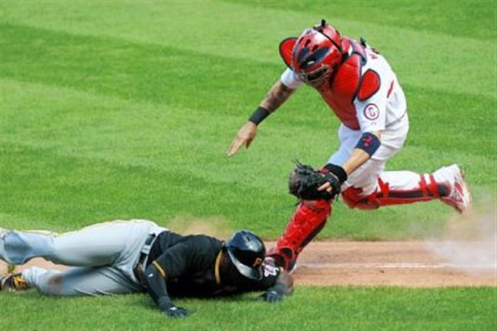 molina Cardinals catcher Yadier Molina tags out Josh Harrison in a rundown Thursday.