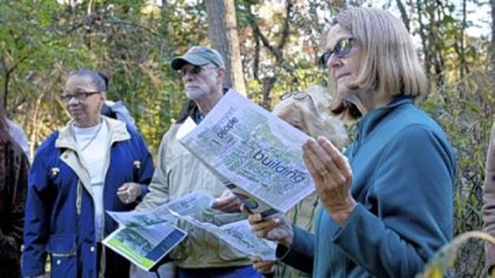 Monica Frolander-Ulf reads Monica Frolander-Ulf reads about the proposal for the new Frick Park Environmental Center during a nature walk Thursday hosted by the Pittsburgh Parks Conservancy.