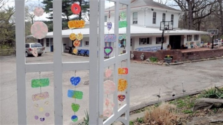 Montessori 2 Plastic beads, melted in shaped baking pans and mounted on old screen door frames, become suncatchers at the Montessori Centre Academy.