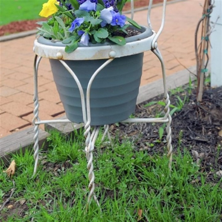 Montessori 3 Old soda fountain chairs have become planters lining sidewalks at the Montessori Centre Academy in Shaler. The project is the brainchild of two of the teachers at the academy, Mary Roche and Gina Roberts.