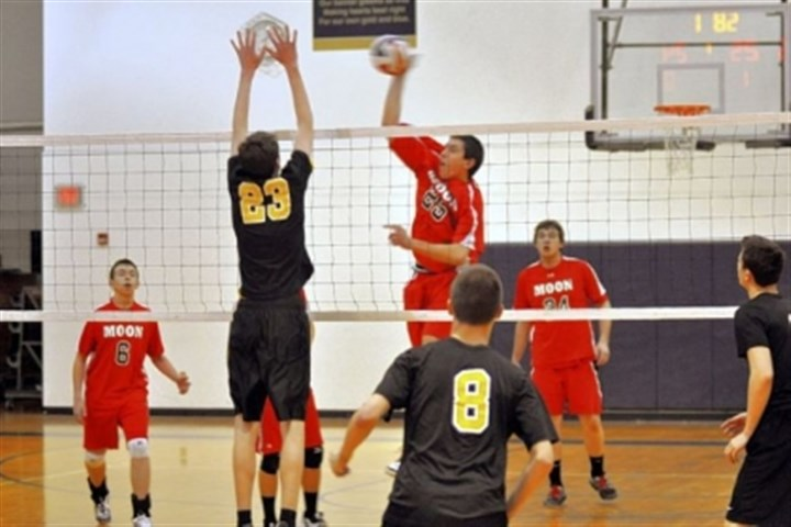 Moon Volleyball Moon junior middle hitter Zach Fuller spikes a shot against Thomas Jefferson.