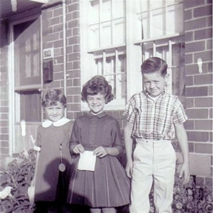 Mooncrest 2 Second-place winner in the Mooncrest photo contest was taken in 1962 and was submitted by Vicky Ramsey. The photo shows Ms. Ramsey, center, her sister, Shelby, left, and her brother, Randall, right, standing in front of their residence.