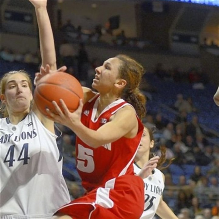 MorganPaige Wisconsin's Morgan Paige, right, shoots around Penn State's Tori Waldner Thursday in University Park, Pa. Penn State won, 84-40.