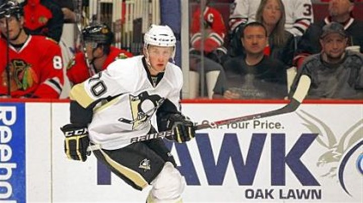 Morrow.jpg The Penguins' No. 4 prospect Joe Morrow skates up the ice against the Chicago Blackhawks in a 2011 preseason game.