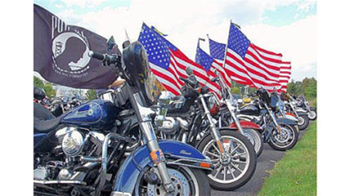 "Motorcycles Motorcycles line the parking lot of Battlefield Harley-Davidson in Gettysburg at the conclusion Saturday of the annual Ride to Gettysburg to benefit the Pennsylvania Monuments Endowment Fund, which state Rep. Harry Readshaw, D-Carrick, established in 1997. The riders who join Mr. Readshaw on his annual ride have become known as ""Readshaw's Raiders."" The ride began in 2001."