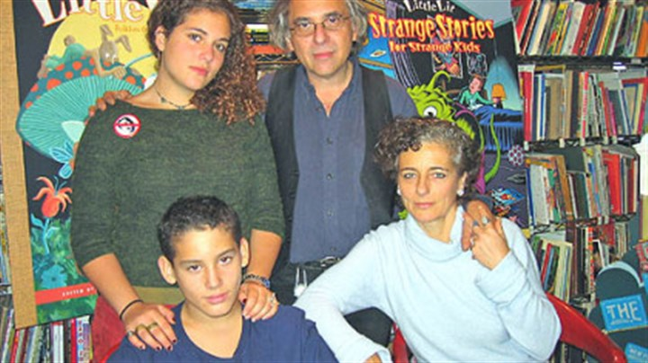 Mouly and Spiegelman Francoise Mouly, right front, and husband Art Spiegelman created a line of hard-cover comic books for beginning readers last year. Also pictured are the couple's daughter, Nadja, and son, Dash, who was the inspiration for the series.
