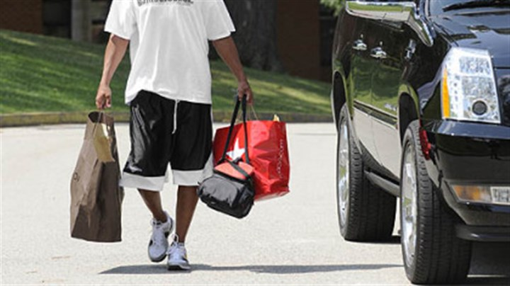 Moving in Hines Ward carries his stuff into the dorm at St. Vincent College at the start of training camp.