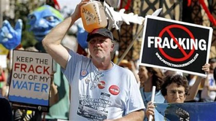 "MSC protest Ray Kemble of Dimock, Pa., on Thursday marches with a jug of his well water outside a Marcellus Shale industry conference where Gov. Tom Corbett attacked anti-drilling activists as the ""unreasoning opposition."""