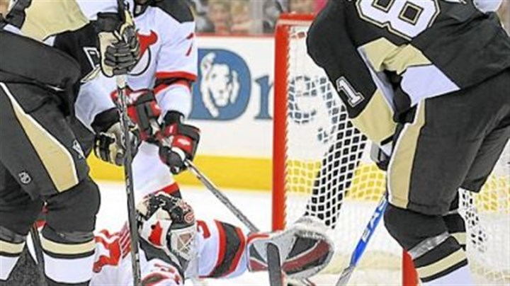 Muscle man Miroslav Satan muscles the Penguins' only goal of the game past New Jersey goaltender Martin Brodeur.
