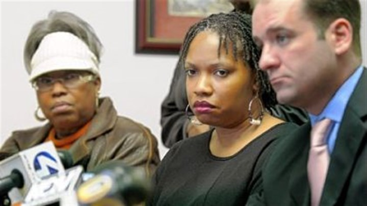 NAACP news conference Terez Miles, center, mother of Jordan Miles, who was beaten by three police officers in Homewood, listens during a news conference held by the NAACP on Wednesday. At left is her mother, Patricia Porter, and, at right, her attorney John K. Lewis.