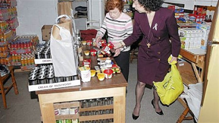 Nancy Heil and Dorothy Kirkpatrick Dorothy Kirkpatrick, left, helps Nancy Heil pack bags of food.