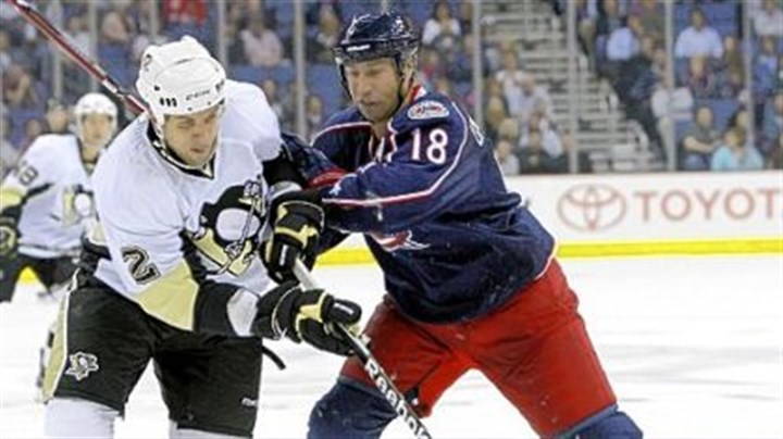 Nate Guenin and R.J. Umberger Blue Jackets forward R.J. Umberger and Penguins defenseman Nate Guenin chase a loose puck during the second period of a preseason hockey game Thursday at Nationwide Arena in Columbus.