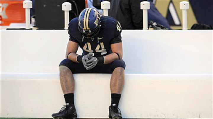 Nate Mix Pitt's Nate Nix sits alone on the bench at the end of his team's loss to West Virginia at Heinz Field Friday.