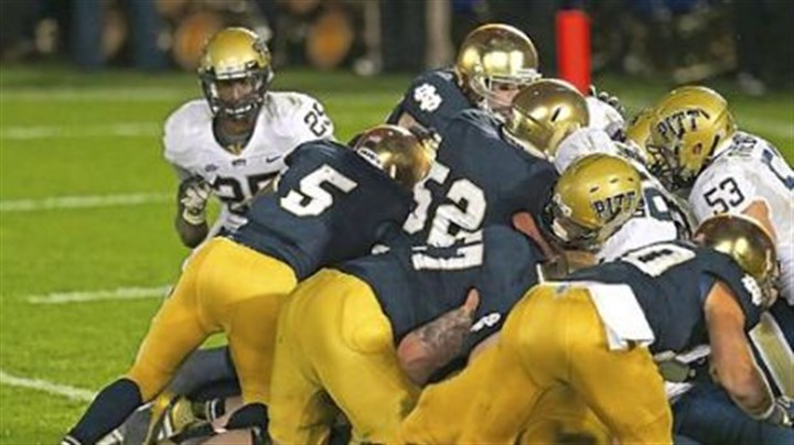 ND Golson Notre Dame quarterback Everett Golson follows blockers into the end zone to score the winning touchdown in the third overtime against Pitt Saturday at Notre Dame Stadium.