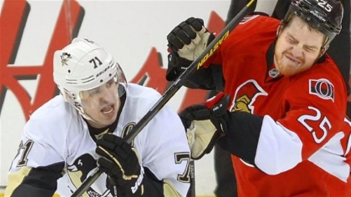 neil Evgeni Malkin of the Penguins is tied up by the Senators' Sunday in Game 3 at Ottawa.