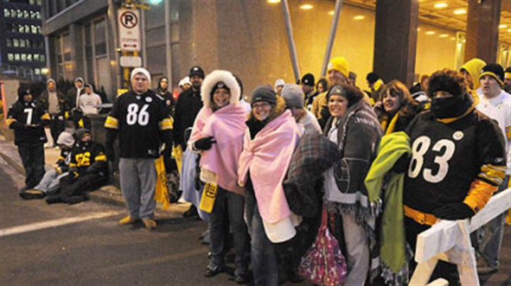Never too cold for Steelers fans Steelers fans gather next to the grandstand, waiting for the noon parade.