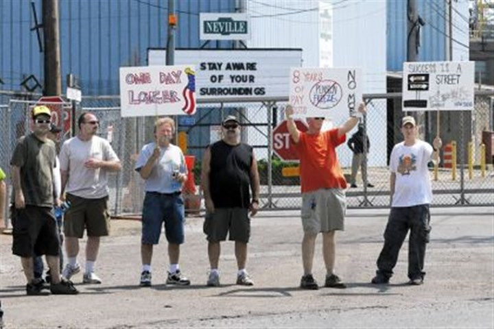 Neville Chemical Company Union workers from the Neville Chemical Company stand outside the gates Monday morning.