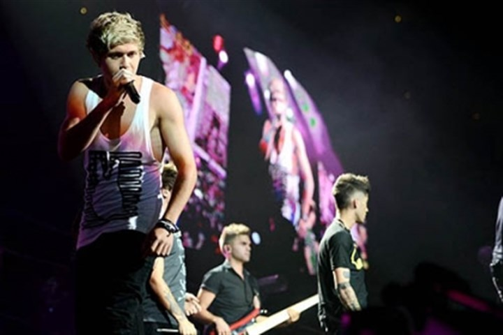 Niall Horan Niall Horan, left, of the band One Direction performs with the group at the Consol Energy Center.