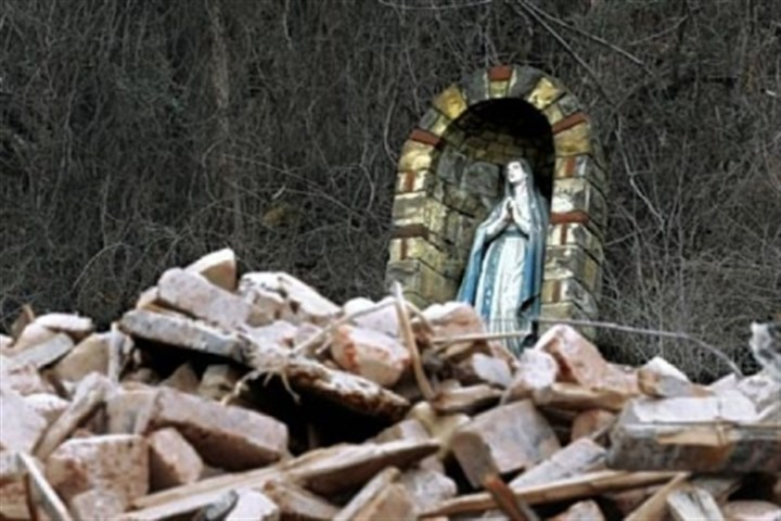 nick The Virgin Mary overlooks the rubble of what used to be St. Nicholas Church on Route 28.