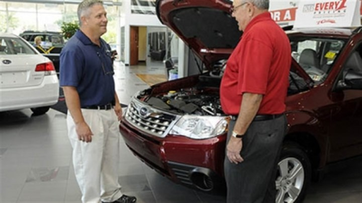 No. 1 Cochran's Subaru showroom Sales representative Harry Gosnell, left, with customer David Goldblum of Connellsville at No. 1 Cochran's Subaru showroom in Monroeville. Major car dealers in the area had a strong sales year.