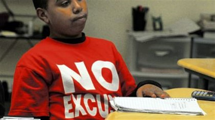 "No excuses Jonathan Williams sports his ""No Excuses"" T-shirt in his math/science class at the Propel School in McKeesport."