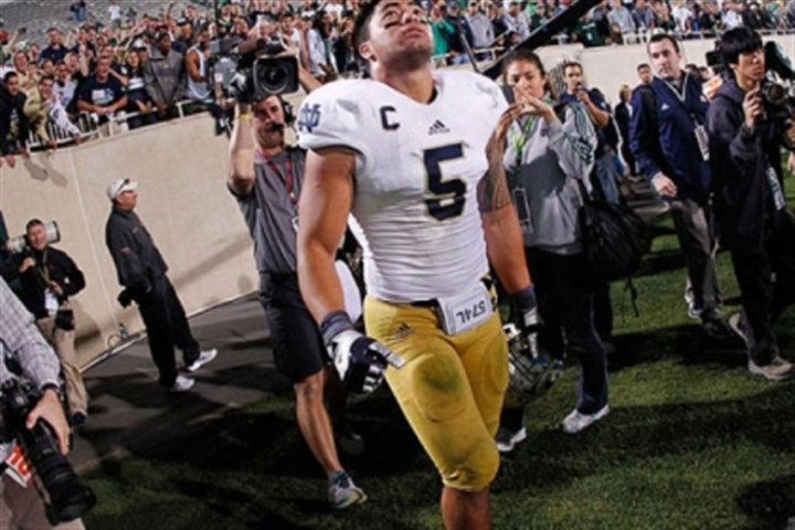 Notre Dame Manti Te'o reacts after Notre Dame defeated Michigan State on September 15, 2012 in East Lansing, Mich. The game capped a week in which Mr. Te'o's grandmother died and he claimed his fictional girlfriend died of leukemia.