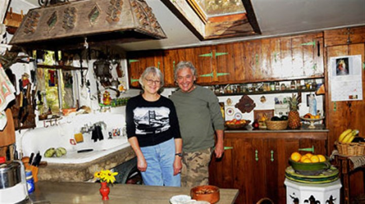November November: Ted and Kathy Carns in their Stone Camp house near Ligonier.