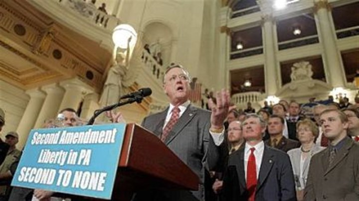 NRA president John Sigler, president of the National Rifle Association address the crowd during a gun rights rally in the Capitol rotunda yesterday.