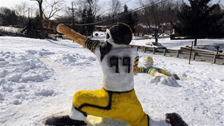 O'Block Playground Snow sculptures of the Steelers are frozen in battle at the O'Block Playground near the entrance of Boyce Park. Some of the snowmen were painted as Green Bay Packers.