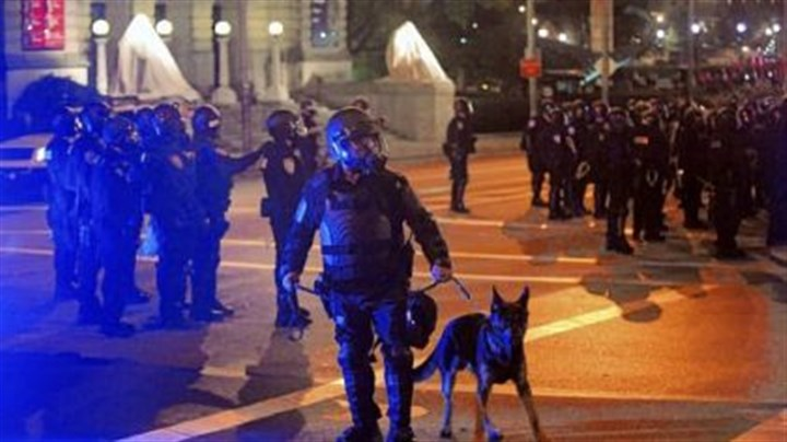 Oakland 3 Riot police respond to the crowd gathered in Schenley Plaza.