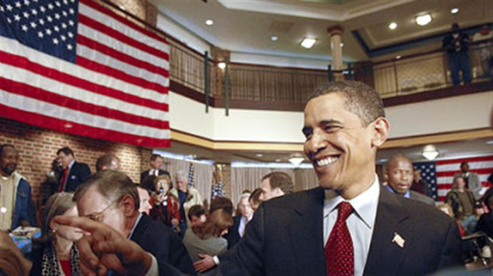 Obama at W&J Sen. Barack Obama greets supports after holding a town hall meeting at Rossin Campus Center at Washington and Jefferson College in Washington, Pa., yesterday. The senator wears an American flag pin in his lapel after it was given to him by a disabled veteran. Radio and cable news commentators pounced on the senator when he was seen not wearing such a pin during the campaign in Iowa.
