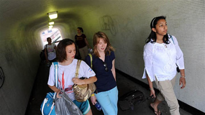 Off to the White House From left, Mikayla Sonneborn, 16, of West Finley; Kara Curry, 16, of Wind Ridge, and Chareeni Kurukulasuriya, 15, of Shadyside walk at Station Square to a bus bound for a mentoring meeting with President Barack Obama today at the White House.